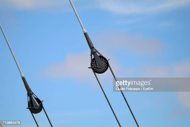 Low Angle View Of Pulley Against Blue Sky