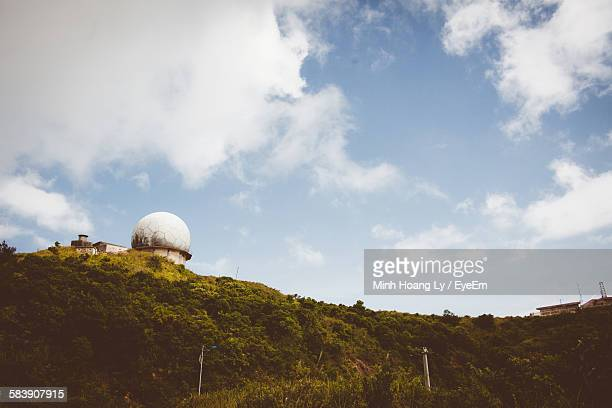 Low Angle View Of Radar Tower On Mountain Against Sky