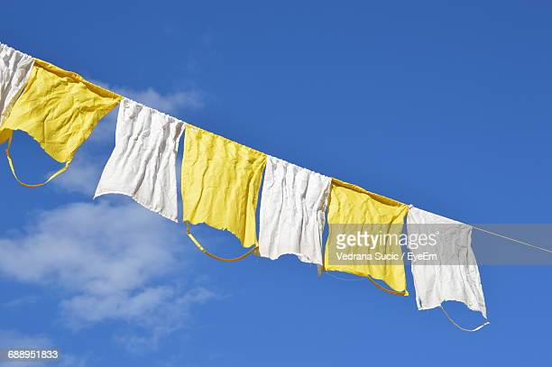 Low Angle View Of Rags Against Blue Sky