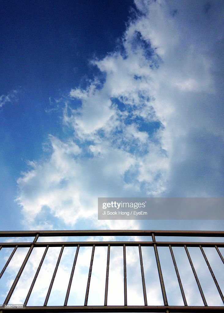 Low Angle View Of Railing Against Blue Cloudy Sky : Stock Photo
