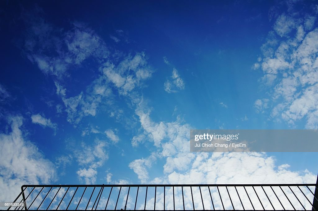 Low Angle View Of Railing Against Blue Sky : Stock Photo