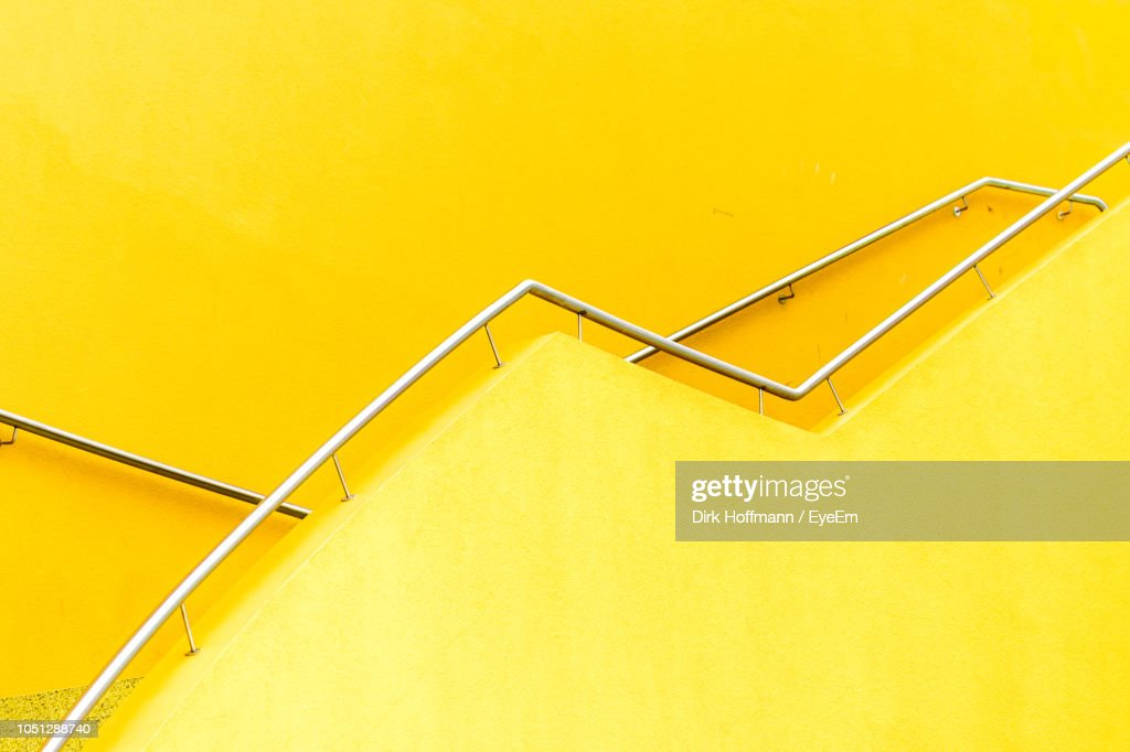 Low Angle View Of Railing On Yellow Wall : Stock-Foto