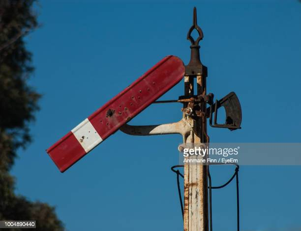 Low Angle View Of Railway Signal Against Clear Blue Sky