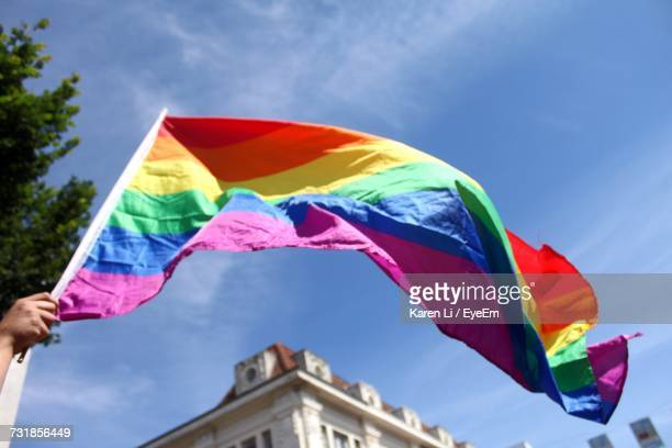 Low Angle View Of Rainbow Flag Against Sky