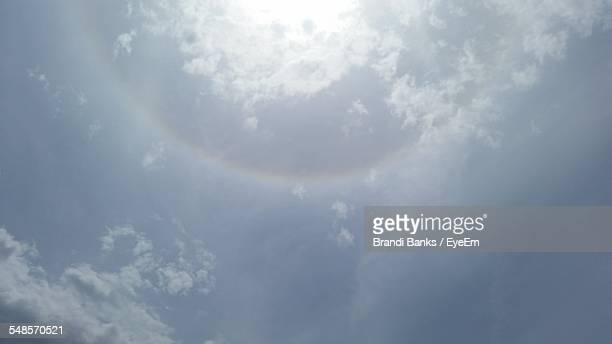 Low Angle View Of Rainbow In Cloudy Sky