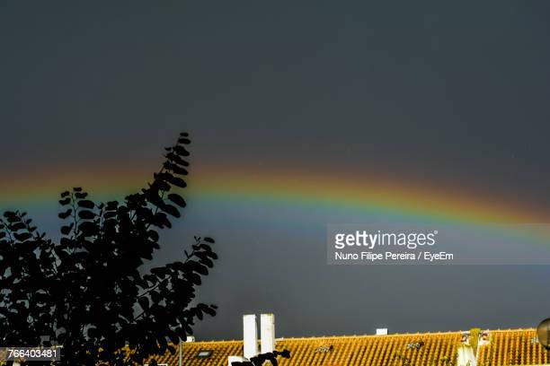 Low Angle View Of Rainbow In Sky At Night