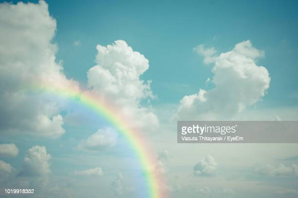 low angle view of rainbow in sky - rainbow stock pictures, royalty-free photos & images