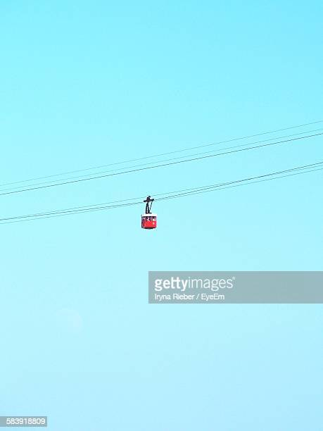 Low Angle View Of Red Cable Car Against Clear Sky