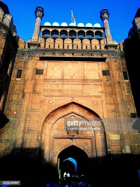 low angle view of red fort against clear sky - mughal empire stock photos and pictures