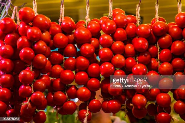 Low Angle View Of Red Fruits Hanging At Market
