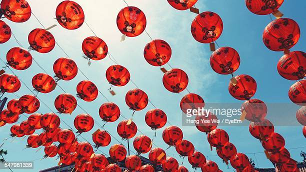 Low Angle View Of Red Lanterns Against Sky