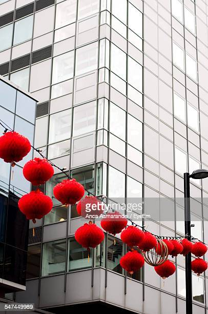 Low Angle View Of Red Lanterns Hanging In Front Of Buildings