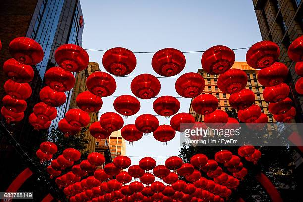Low Angle View Of Red Lanterns Hanging On The Street