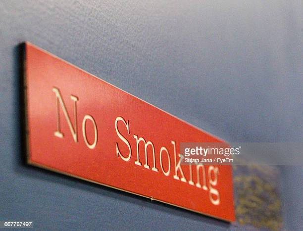 Low Angle View Of Red No Smoking Sign On Wall