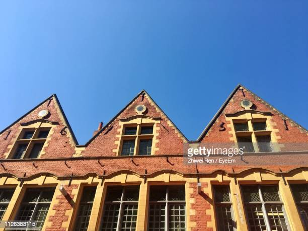 low angle view of residential building against clear sky - france lille stock pictures, royalty-free photos & images