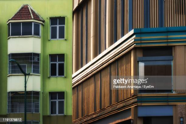 low angle view of residential building - ricchi e poveri foto e immagini stock