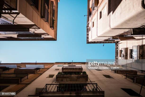 low angle view of residential buildings against clear sky - christian soldatke fotografías e imágenes de stock