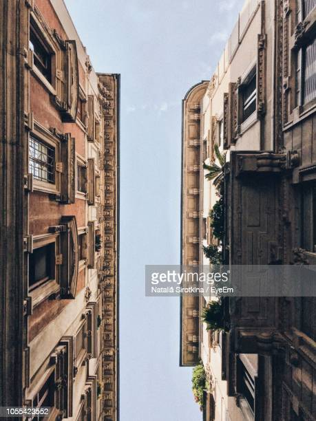 low angle view of residential buildings against sky - inquadratura dal basso foto e immagini stock