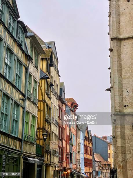 low angle view of residential buildings against sky - rouen stock pictures, royalty-free photos & images