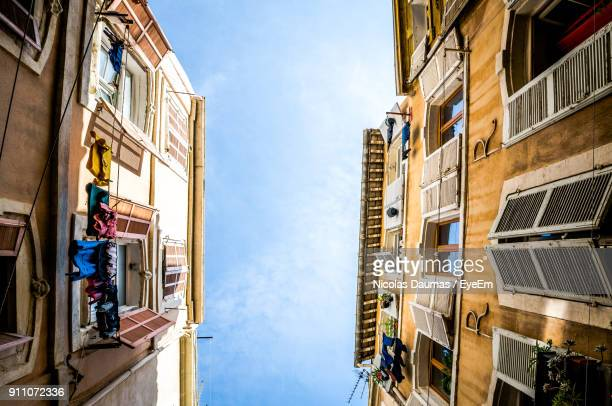 low angle view of residential buildings against sky - marseille photos et images de collection