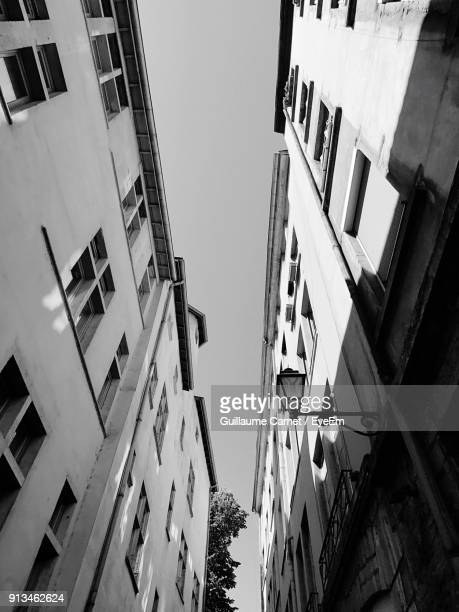 low angle view of residential buildings against sky - carnet stock photos and pictures