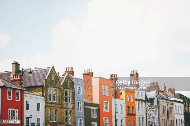 low angle view of residential buildings against sky - oxford england stock pictures, royalty-free photos & images