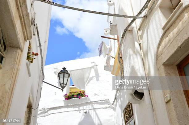 low angle view of residential buildings against sky - ostuni stock photos and pictures