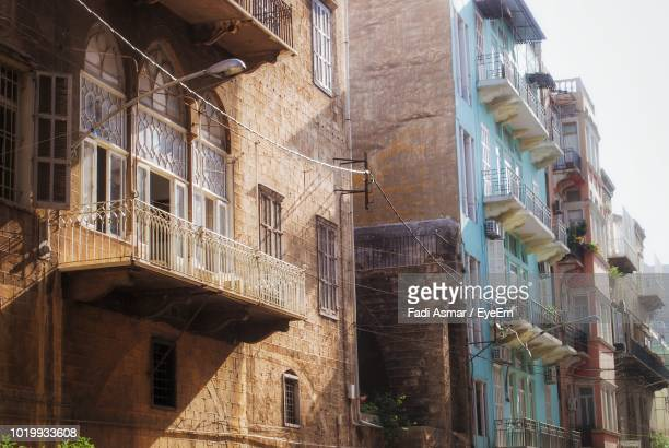 low angle view of residential buildings - old beirut stock photos and pictures