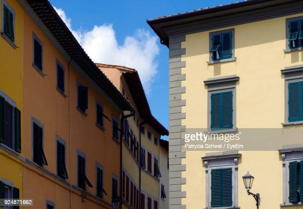 low angle view of residential buildings - san miniato stock pictures, royalty-free photos & images