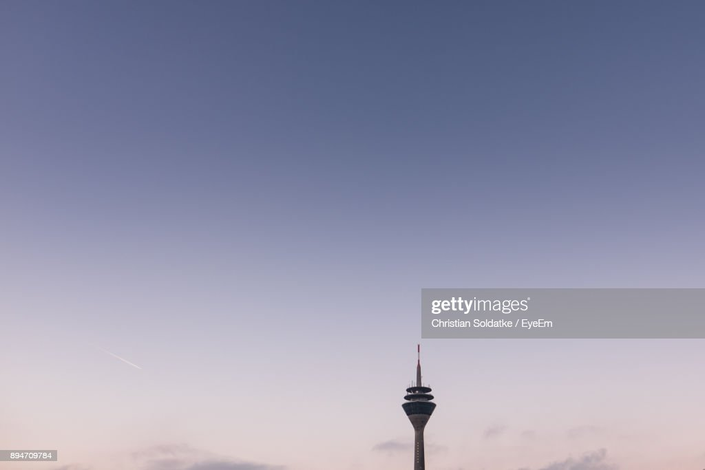 Low Angle View Of Rheinturm Tower Against Sky During Sunset : Stock-Foto