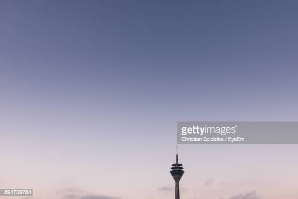 low angle view of rheinturm tower against sky during sunset - christian soldatke stock pictures, royalty-free photos & images