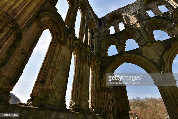 low angle view of rievaulx abbey against sky - rievaulx abbey stock pictures, royalty-free photos & images