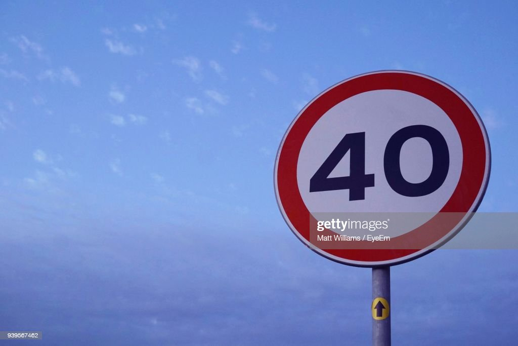 Low Angle View Of Road Sign Against Blue Sky : Stock Photo