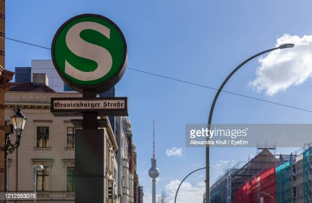 low angle view of road sign against buildings - alexandra krull stock-fotos und bilder