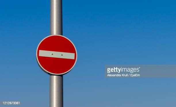 low angle view of road sign against clear blue sky - alexandra krull stock-fotos und bilder