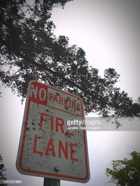 low angle view of road sign against clear sky - jennifer reed stock pictures, royalty-free photos & images