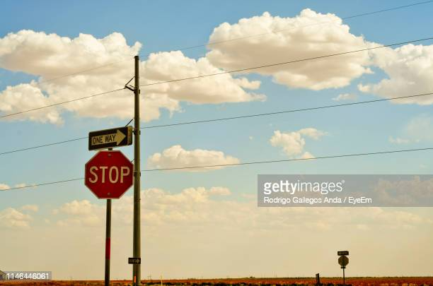 low angle view of road sign against sky - ルボック ストックフォトと画像