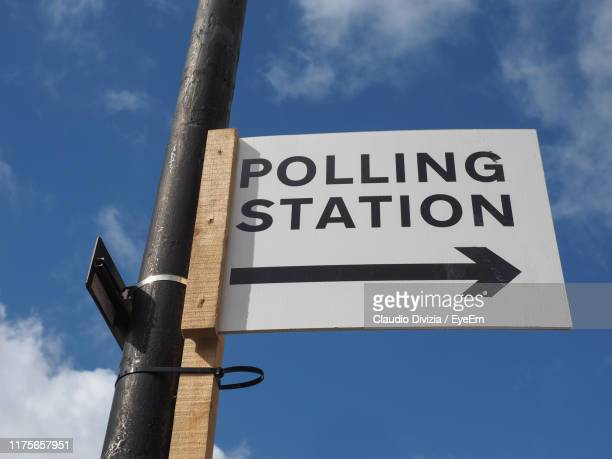 low angle view of road sign against sky - election stock pictures, royalty-free photos & images
