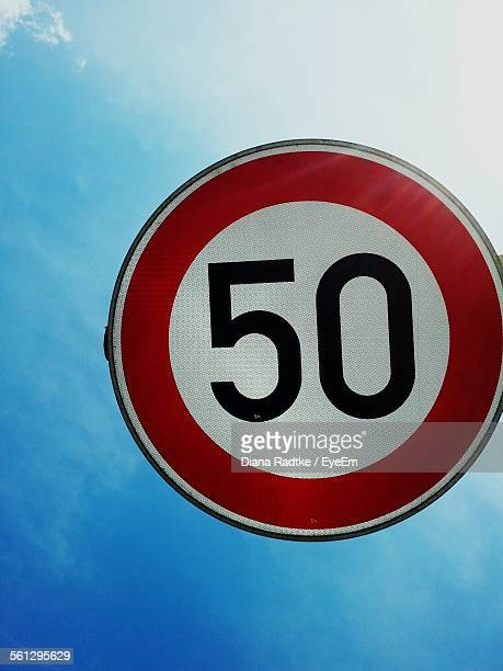 low angle view of road sign against sky - number 50 stock photos and pictures