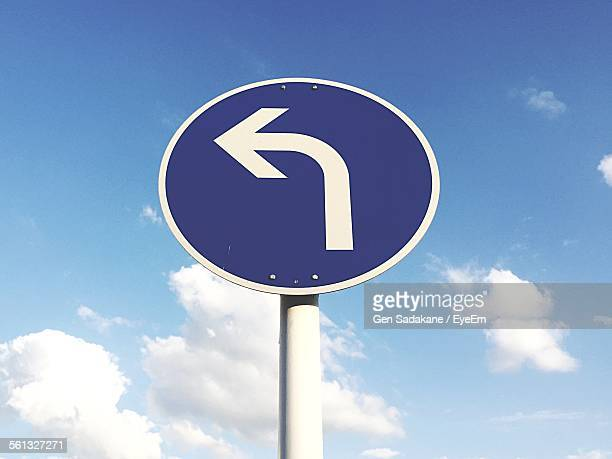 Low Angle View Of Road Sign Against Sky