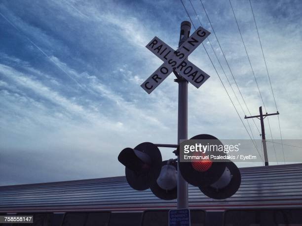 low angle view of road sign against sky - crossing sign stock pictures, royalty-free photos & images
