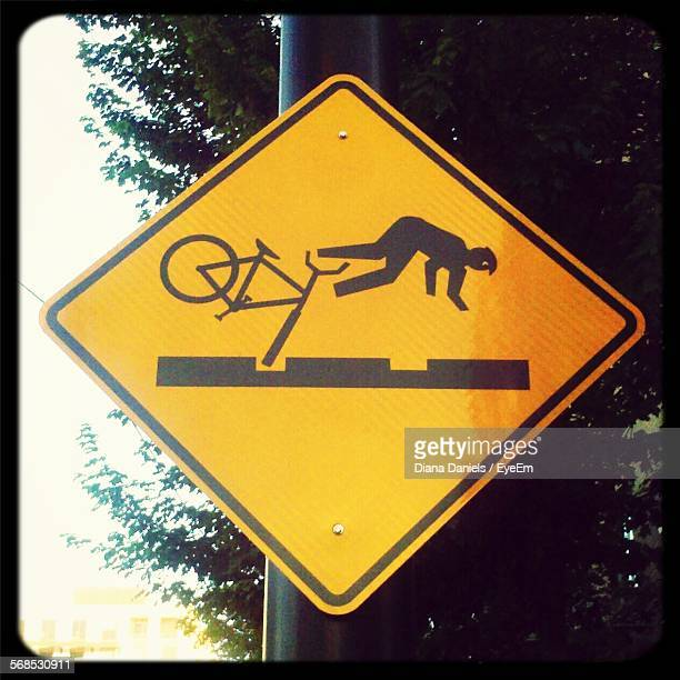 low angle view of road sign against tree - diana daniels stock-fotos und bilder