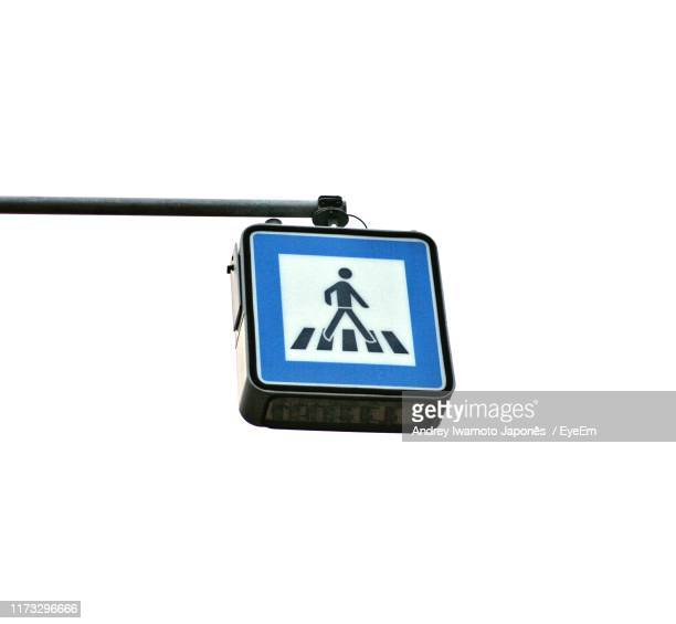 low angle view of road sign against white background - japonês stock pictures, royalty-free photos & images
