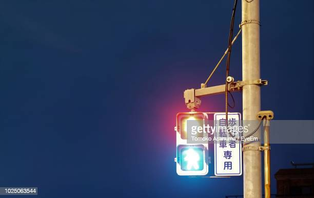low angle view of road signal against blue sky - road signal stock pictures, royalty-free photos & images