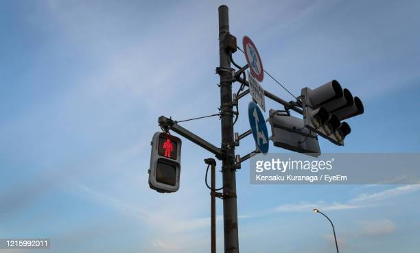 low angle view of road signal against sky - 交通信号機 ストックフォトと画像