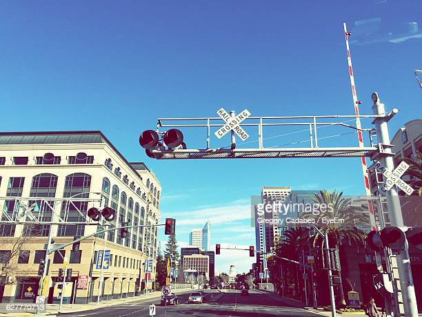 low angle view of road signal on street amidst buildings - sacramento stock pictures, royalty-free photos & images