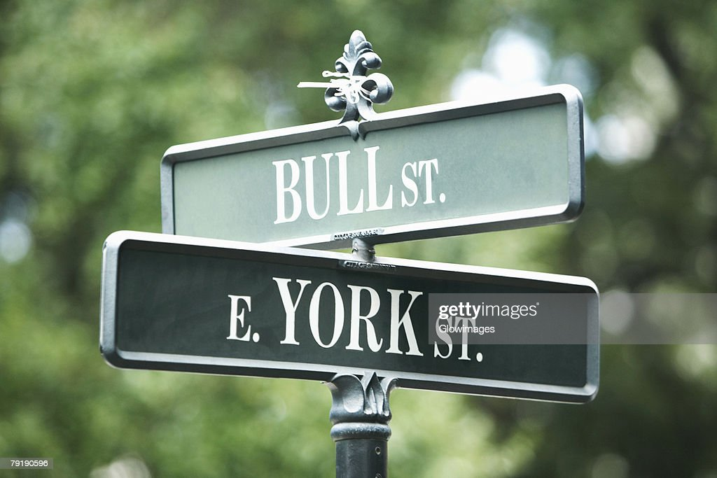 Low angle view of road signs : Foto de stock