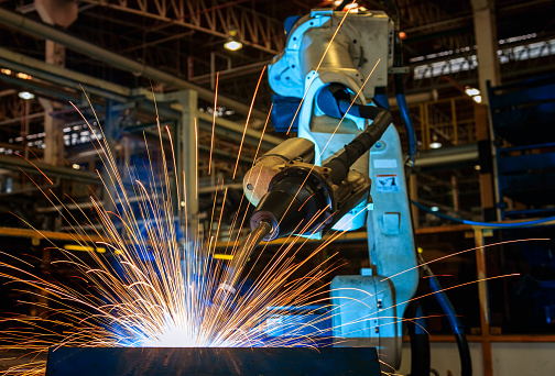 Low Angle View Of Robot Welding At Factory - gettyimageskorea