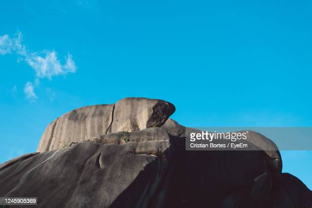low angle view of rock against blue sky - bortes stock pictures, royalty-free photos & images