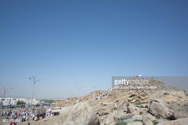 low angle view of rock against clear blue sky - pilgrimage stock pictures, royalty-free photos & images